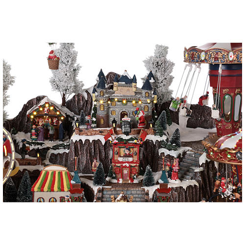 Pueblo navideño atracciones castillo movimiento luces 55x85x55 cm 5