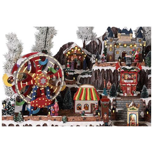 Pueblo navideño atracciones castillo movimiento luces 55x85x55 cm 8