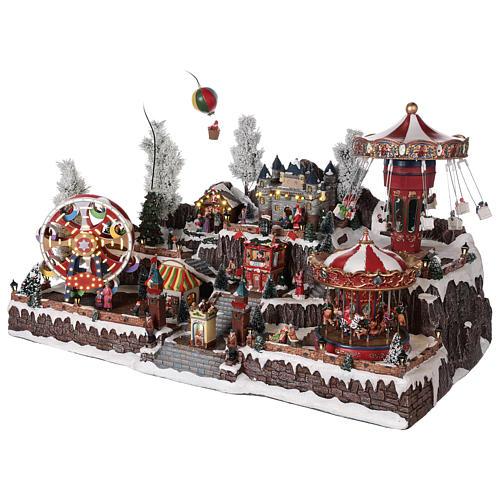 Villaggio natalizio giostre castello movimento luci 55x85x55 cm 3