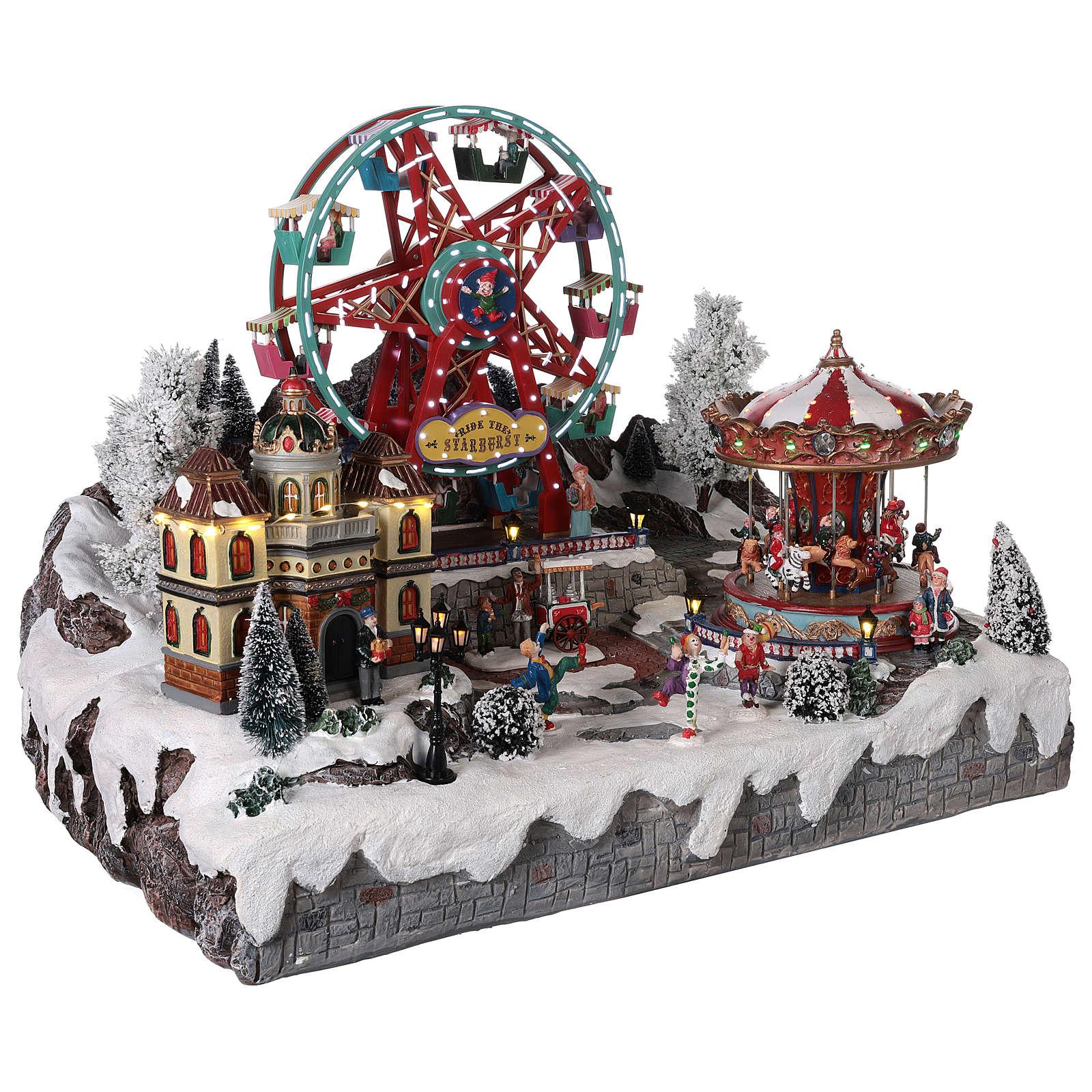 Village Noël roue panoramique manège mouvement lumières 50x50x45 cm 3