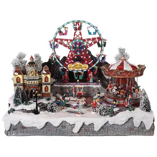 Village Noël roue panoramique manège mouvement lumières 50x50x45 cm 1