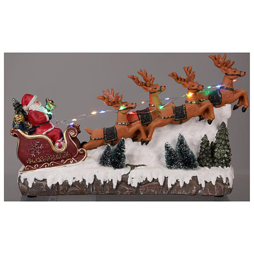 Christmas village Santa's sleigh with lights and music 25x40x10 cm 2