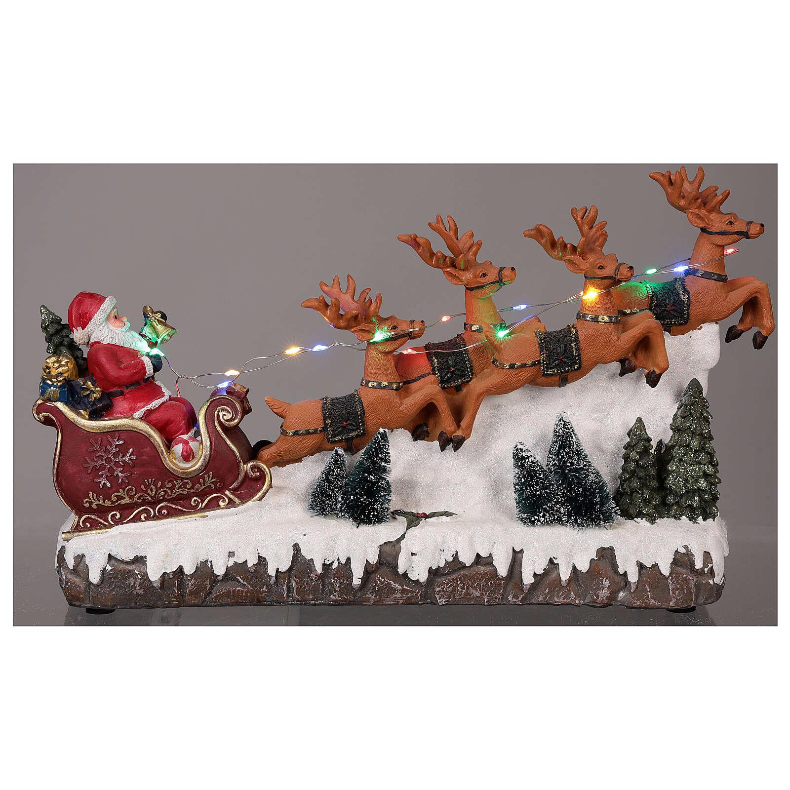 Pueblo navideño trineo de Papá Noel renos luz música 25x40x10 3