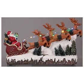 Pueblo navideño trineo de Papá Noel renos luz música 25x40x10 s2