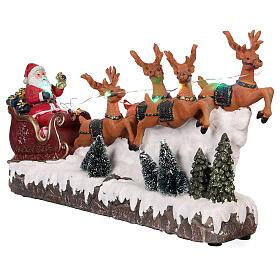 Pueblo navideño trineo de Papá Noel renos luz música 25x40x10 s3