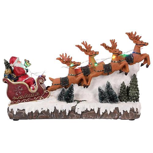 Pueblo navideño trineo de Papá Noel renos luz música 25x40x10 1