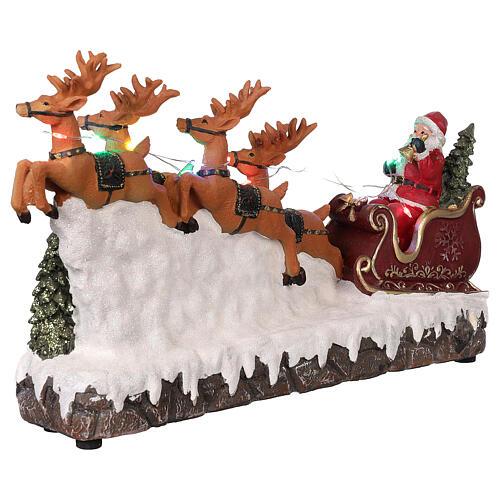 Pueblo navideño trineo de Papá Noel renos luz música 25x40x10 4