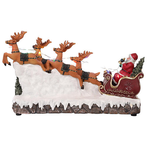 Pueblo navideño trineo de Papá Noel renos luz música 25x40x10 5