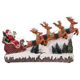 Cenários Natalinos em Miniatura: Cenário natalio trenô de Pai Natal com renas luzes música  25x40x10 cm