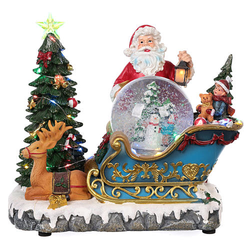Trineo Papá Noel esfera nevada movimiento luz música 25x30x20 1