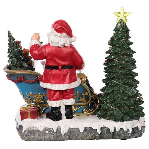 Trineo Papá Noel esfera nevada movimiento luz música 25x30x20 5