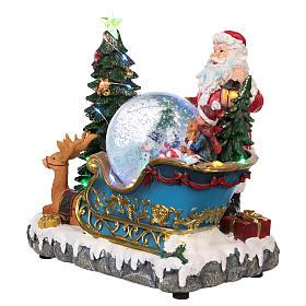 Traîneau Père Noël boule à neige mouvement lumières musique 25x30x20 cm s3