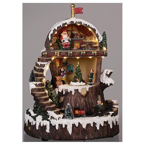 Pueblo navideño con Papá Noel movimiento luz música 30x25x20 2