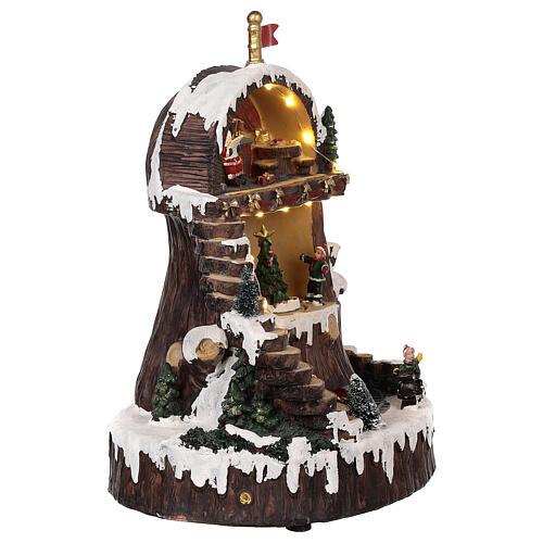 Pueblo navideño con Papá Noel movimiento luz música 30x25x20 4