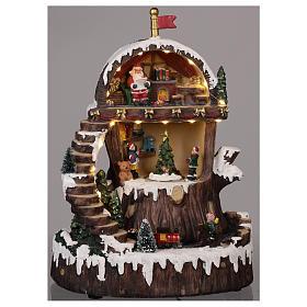 Village de Noël avec Père Noël mouvement lumières musique 30x25x20 cm s2