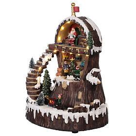 Village de Noël avec Père Noël mouvement lumières musique 30x25x20 cm s3