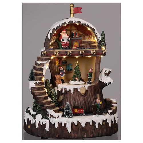 Village de Noël avec Père Noël mouvement lumières musique 30x25x20 cm 2