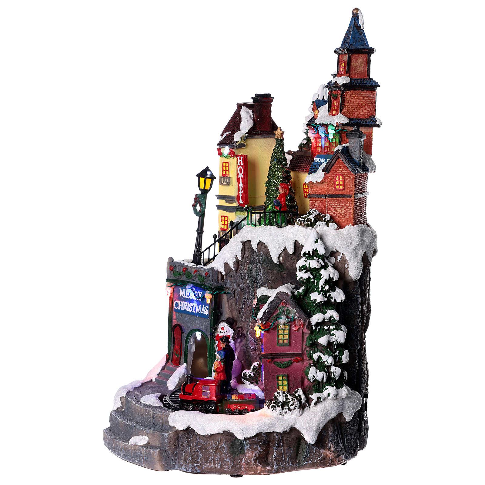 Pueblo navideño con tiendas movimiento luz música 35x20x20 3