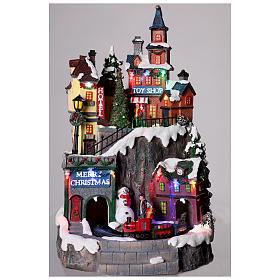Pueblo navideño con tiendas movimiento luz música 35x20x20 s2