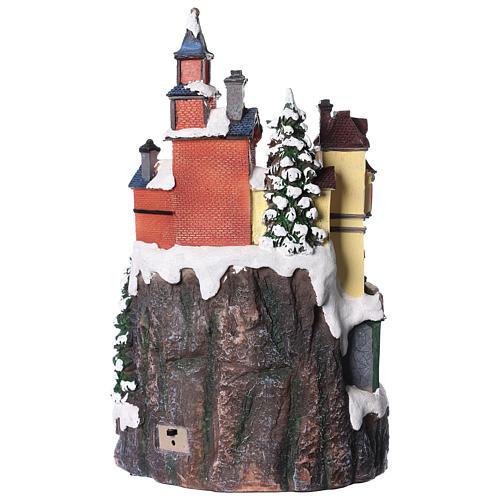 Village de Noël avec magasins mouvement lumière musique 35x20x20 cm 5