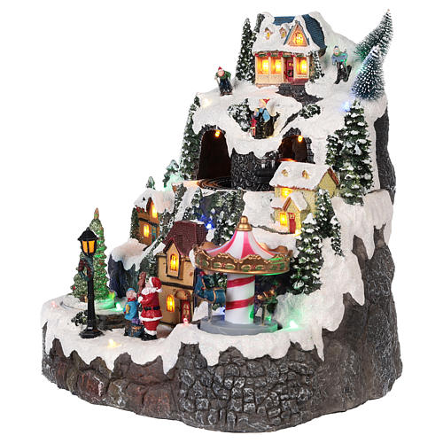 Christmas village, snowed mountain and carousel with movements, lights and music 50x40x15 cm 3