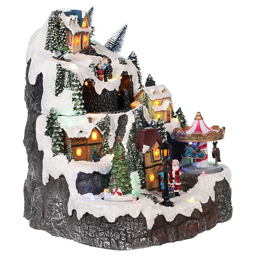 Christmas village, snowed mountain and carousel with movements, lights and music 50x40x15 cm 4