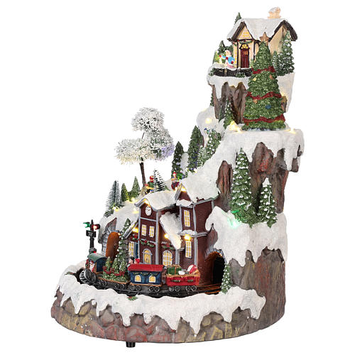 Christmas village with moving elements, lights and music 35x45x35 cm 3