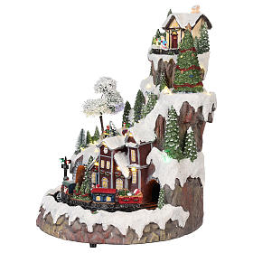 Mountain Christmas village with snow train motion lights music 35x45x35 cm s3