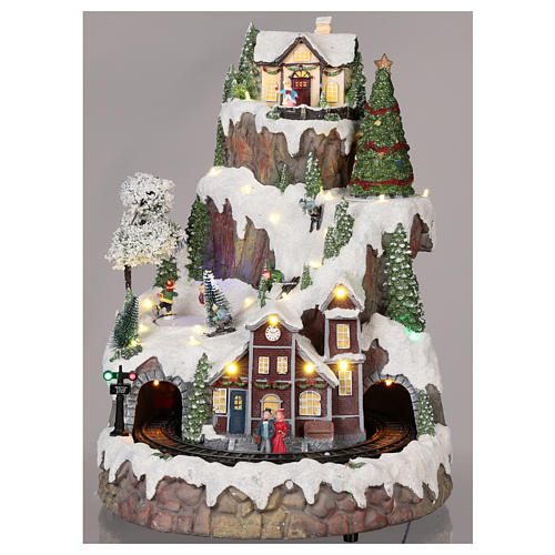 Mountain Christmas village with snow train motion lights music 35x45x35 cm 2