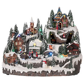 Christmas village with moving elements, lights and music 40x30x30 cm s1