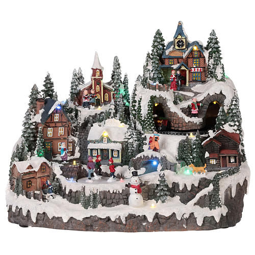 Christmas village with moving elements, lights and music 40x30x30 cm 1