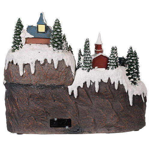 Christmas village with moving elements, lights and music 40x30x30 cm 5