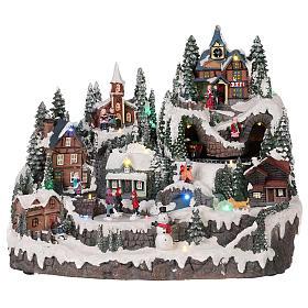 Villages de Noël miniatures: Village Noël piste de patinage manège mouvement lumières musique 40x30x30  cm