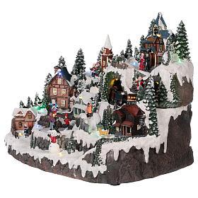 Village Noël piste de patinage manège mouvement lumières musique 40x30x30 cm s3