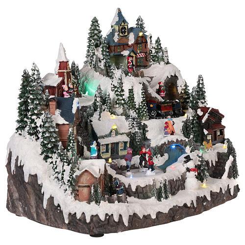 Village Noël piste de patinage manège mouvement lumières musique 40x30x30 cm 4