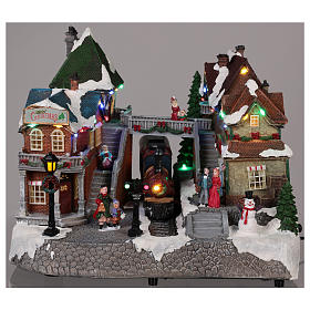Christmas village train station with moving elements, lights and music 25x35x25 cm s2