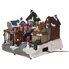 Christmas village train station with moving elements, lights and music 25x35x25 cm s3