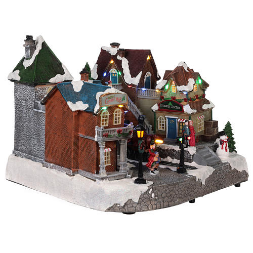 Christmas village train station with moving elements, lights and music 25x35x25 cm 4