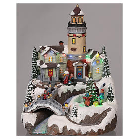 Christmas village with lighthouse, moving elements, lights and music 35x25x25 cm s2