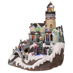 Village Noël avec phare mouvement lumières musique 35x25x25 cm s3
