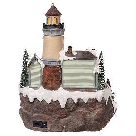 Village Noël avec phare mouvement lumières musique 35x25x25 cm s5