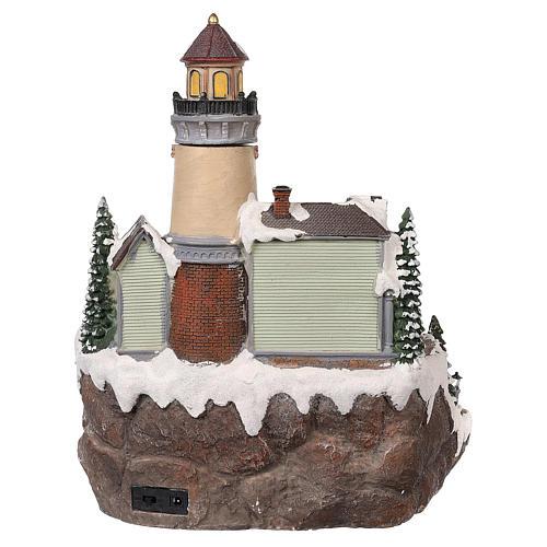 Village Noël avec phare mouvement lumières musique 35x25x25 cm 5