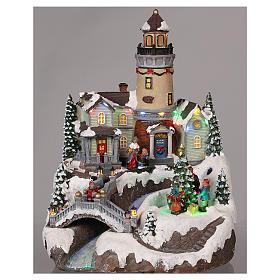 Villaggio natalizio con faro movimento luce musica 35x25x25 cm s2