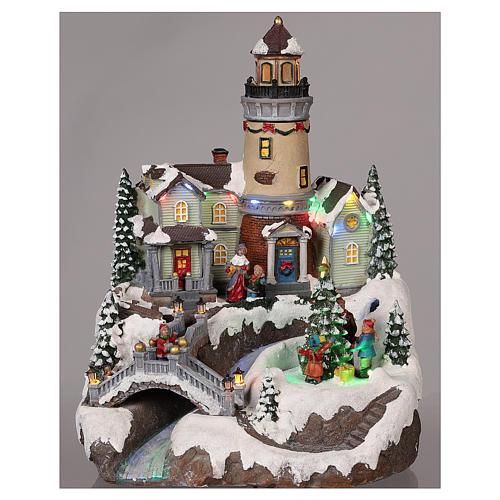 Villaggio natalizio con faro movimento luce musica 35x25x25 cm 2