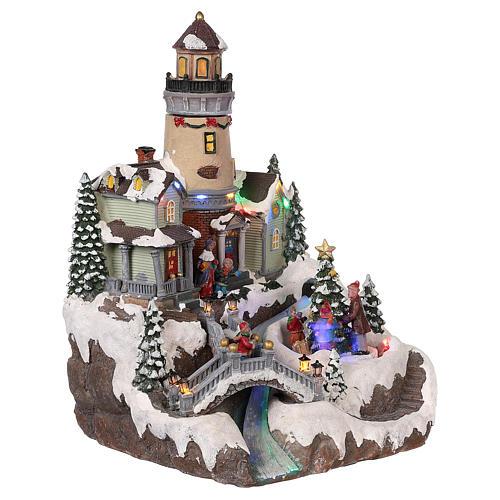 Villaggio natalizio con faro movimento luce musica 35x25x25 cm 4