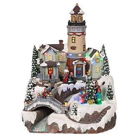 Cenários Natalinos em Miniatura: Cenário de Natal com farol movimento luzes música 35x25x25 cm