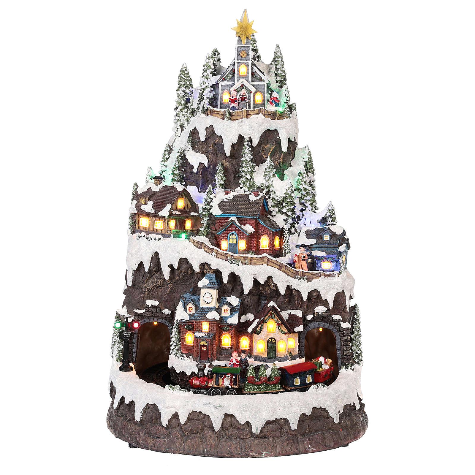 Pueblo navideño montaña nevada movimiento luz música 50x35x30 3