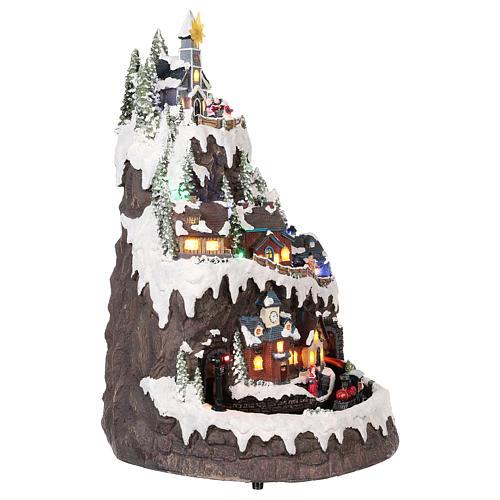 Pueblo navideño montaña nevada movimiento luz música 50x35x30 4