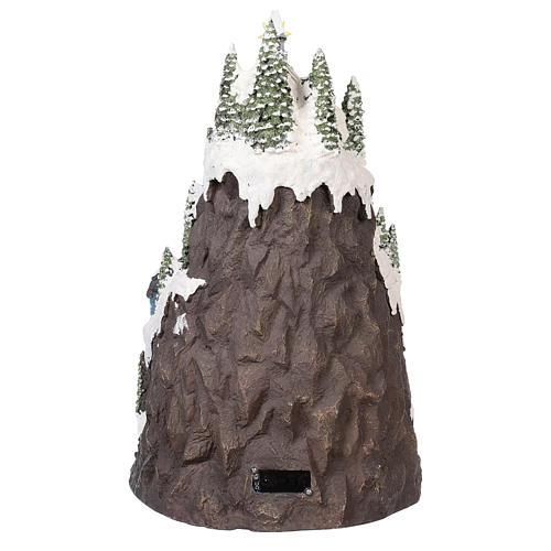 Pueblo navideño montaña nevada movimiento luz música 50x35x30 5