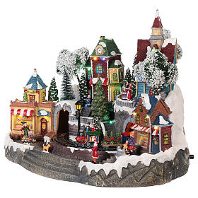 Christmas village with shops, moving elements, lights and music 35x45x35 cm s3
